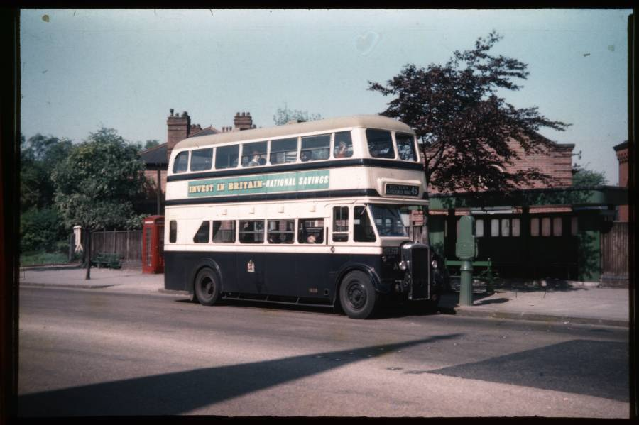 "HOV 928 at Cotteridge.  Numbered 45, the sign on the front says, ""West Heath Alvechurch Road"", although it is facing the into city direction - it was Birmingham City Transport practice to show the outer terminus destination all the time.  A chap downstairs in having a nap in the sunshine!"