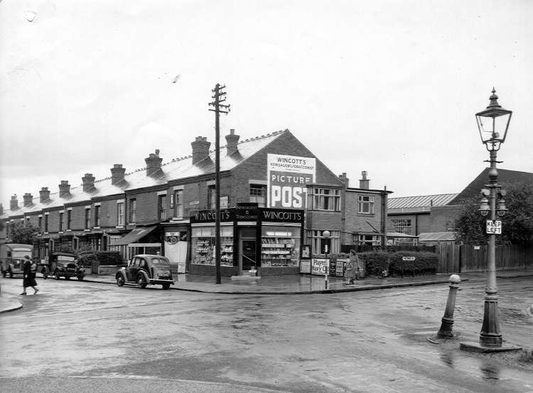 1951. This picture was taken from the corner of Watford Road and Northfield road and shows Wincott's Newsagent and Tobacconist on the opposite corner of Watford Road and Rowheath Road. Note the attractive lamppost to the right, probably still gas powered at this time - note the two little extra lamps to illuminate the 'keep left' sign.