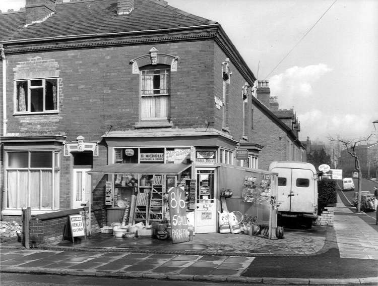 On the corner of Midland Road and Rowheath Road was this store owned by D Nicholls. Amongst the items on display are step ladders, bowls, mops, buckets, coal, seeds, plants and watering cans.