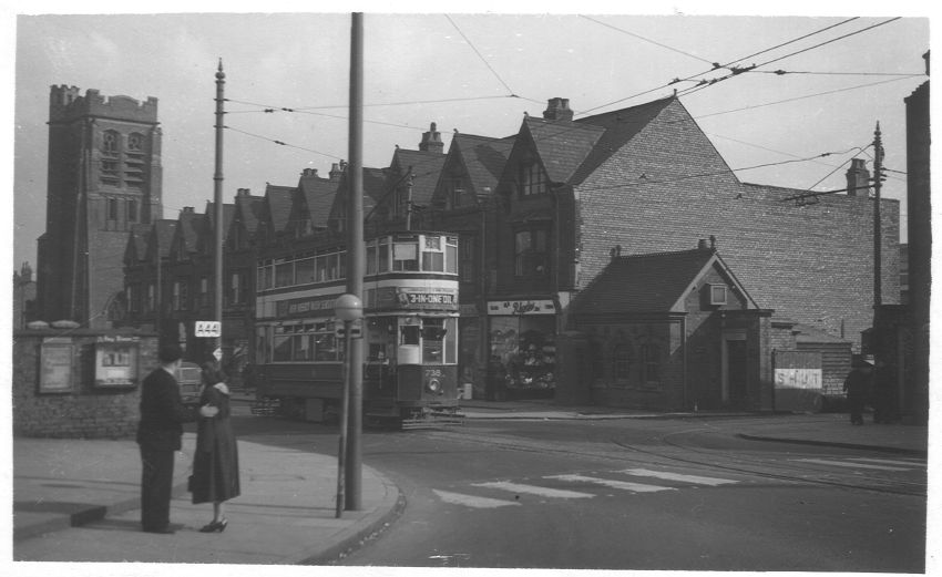 Looking towards Pershore Road from Watford Road, with St Agnes Church visible. The driveway to the right of the picture leads to the former bus depot, but the tracks leading that way suggest it was a tram depot before that.
