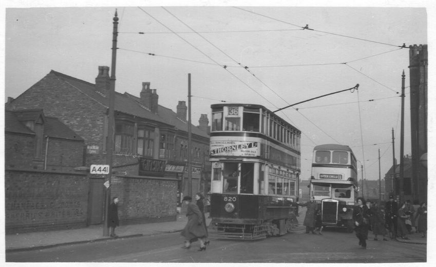 Tram in the heart of Cotteridge, 1952.  Note the conductress from the tram has the trolley rope in her hand as she prepares for the tram to change direction.  Also, note the bobby on his bike on the far right hand side.